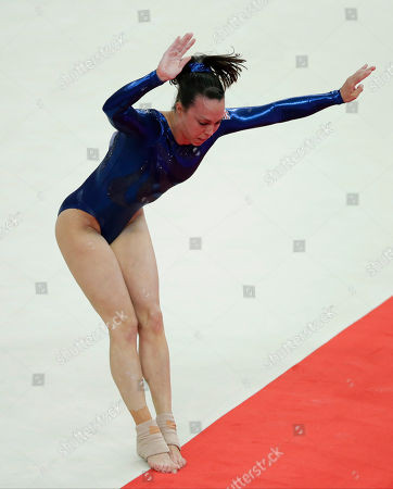 Gymnast Elizabeth Tweddle from Britain lands outside the boundaries of the mat as she performs on the floor during the Artistic Gymnastic women's team final at the 2012 Summer Olympics, in London