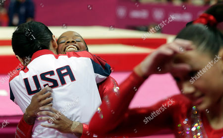 U.S. gymnast Gabrielle Douglas is hugged by U.S. coach Jenny Zhang after her performance on the beam during the Artistic Gymnastics women's team final at the 2012 Summer Olympics, in London