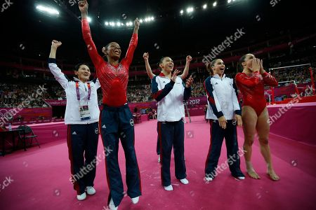 U.S. gymnasts, front left to right, Gabrielle Douglas, Kyla Ross, McKayla Maroney and Jordyn Wieber celebrate along with coach Jenny Zhang as they look at the score of a teammate's performance during the Artistic Gymnastics women's team final at the 2012 Summer Olympics, in London