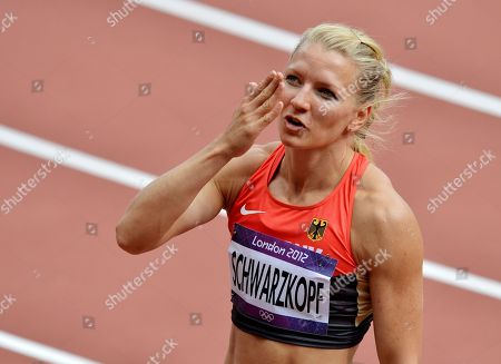 Germany's Lilli Schwarzkopf reacts after the 100-meter hurdles of the Women's Heptathlon at the athletics in the Olympic Stadium at the 2012 Summer Olympics, London