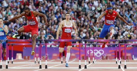 From left, United States' Angelo Taylor, Serbia's Emir Bekric and Puerto Rico's Javier Culson compete in a men's 400-meter hurdles semifinal during the athletics in the Olympic Stadium at the 2012 Summer Olympics, London