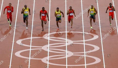 From left, United States' Ryan Bailey, Jamaica's Usain Bolt, United States' Justin Gatlin, Jamaica's Yohan Blake, United States' Tyson Gay, Jamaica's Asafa Powell and Trinidad's Richard Thompson compete in the men's 100-meter final during the athletics in the Olympic Stadium at the 2012 Summer Olympics, London