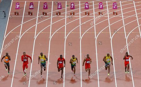 A bottle lies on the track, seen in background, as from left, Netherlands' Churandy Martina, United States' Ryan Bailey, Jamaica's Usain Bolt, United States' Justin Gatlin, Jamaica's Yohan Blake, United States' Tyson Gay, Jamaica's Asafa Powell and Trinidad's Richard Thompson compete in the men's 100-meter final during the athletics in the Olympic Stadium at the 2012 Summer Olympics, London