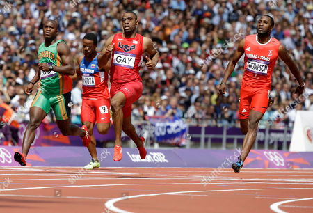 United States' Tyson Gay crosses the finish with Trinidad's Richard Thompson, right, and Zambia's Gerald Phiri, left, in a men's 100-meter heat during the athletics in the Olympic Stadium at the 2012 Summer Olympics, London