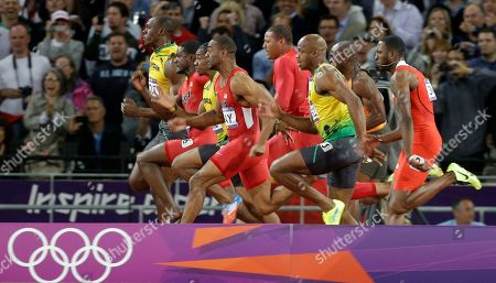 Jamaica's Usain Bolt, left, crosses the finish line to win the gold medal for the men's 100-meter, ahead of compatriot Jamaica's Yohan Blake, third left, Justin Gatlin from the U.S., second left, Tyson Gay from the U.S., fourth form left, Ryan Bailey from the U.S., center rear, Jamaica's Asafa Powell, third from right, Churandy Martina from the Netherlands, second from right rear, and Trinidad's Richard Thompson, right, during the athletics competition in the Olympic Stadium at the 2012 Summer Olympics, London