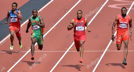 From left, Colombia's Isidro Montoya, Zambia's Gerald Phiri, United States' Tyson Gay, Trinidad's Richard Thompson compete in a men's 100-meter heat during the athletics in the Olympic Stadium at the 2012 Summer Olympics, London