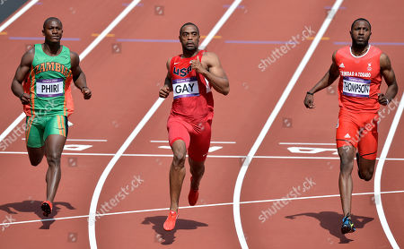 From left, Zambia's Gerald Phiri, United States' Tyson Gay and Trinidad's Richard Thompson compete in a men's 100-meter heat during the athletics in the Olympic Stadium at the 2012 Summer Olympics, London