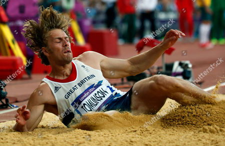 Britain's Christopher Tomlinson makes an attempt during the mens long jump qualification at the athletics competition in the Olympic Stadium at the 2012 Summer Olympics, in London