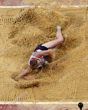 Britain's Christopher Tomlinson competes in the men's long jump final in the Olympic Stadium at the 2012 Summer Olympics, in London