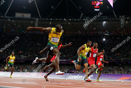 Jamaica's Usain Bolt, foreground left, goes to cross the finish line ahead of Jamaica's Yohan Blake, third from right, United States' Justin Gatlin, fourth from right, United States' Tyson Gay, second from right, and Trinidad's Richard Thompson in the men's 100-meters final during the athletics in the Olympic Stadium at the 2012 Summer Olympics, London