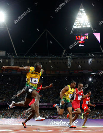 Jamaica's Usain Bolt, left, crosses the finish line ahead of, from second left, United States' Justin Gatlin, Jamaica's Yohan Blake, United States' Tyson Gay, and Trinidad's Richard Thompson in the men's 100-meters final during the athletics in the Olympic Stadium at the 2012 Summer Olympics, London