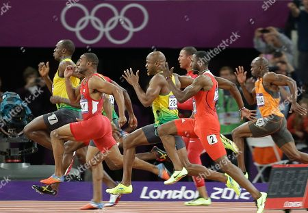 Jamaica's Usain Bolt, front, sprints towards the finish line to win the men's 100-meter final race ahead of Jamaica's Yohan Blake, half hidden, Tyson Gay from the U.S., second in red, Jamaica's Asafa Powell, center in yellow, Ryan Bailey from the U.S.. third from right rear, Trinidad's Richard Thompson. second right, and Churandy Martina from the Netherlands, right, during the athletics competition in the Olympic Stadium at the 2012 Summer Olympics, London