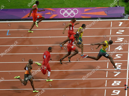 Jamaica's Usain Bolt, right, crosses the finish line to win the men's 100-meter final race ahead of Churandy Martina from the Netherlands, Ryan Bailey from the U.S., Jamaica's Yohan Blake, Tyson Gay from the U.S., Jamaica's Asafa Powell, Trinidad's Richard Thompson, from bottom to top lane, during the athletics competition in the Olympic Stadium at the 2012 Summer Olympics, London