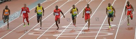 Jamaica's Usain Bolt, third from left, sprints towards the finish line, to win the men's 100-meter ahead of Churandy Martina from the Netherlands, Ryan Bailey from the U.S., Justin Gatlin from the U.S., Jamaica's Yohan Blake, Tyson Gay from the U.S., Jamaica's Asafa Powell, and Trinidad's Richard Thompson, form left to right, during the athletics competition in the Olympic Stadium at the 2012 Summer Olympics, London