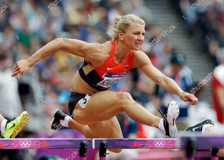 Germany's Lilli Schwarzkopf clears a hurdle the 100-meter hurdles of the Women's Heptathlon at the athletics of the 2012 Summer Olympics in London