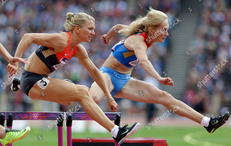 Germany's Lilli Schwarzkopf, left, and Russia's Kristina Savitskaya clear hurdle in the 100-meter hurdles of the Women's Heptathlon at the athletics of the 2012 Summer Olympics in London