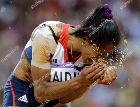 Britain's Yamile Aldama reacts during the women's triple jump final during the athletics in the Olympic Stadium at the 2012 Summer Olympics, London