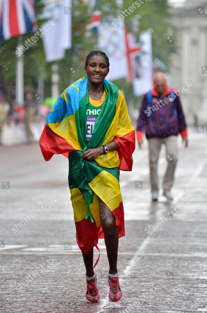 Ethiopia's Tiki Gelana is wrapped in her country's flag after winning gold in the women's marathon at the 2012 Summer Olympics in London