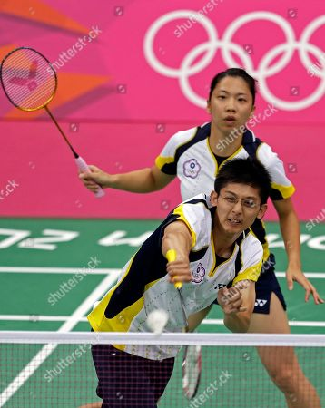 Taiwan's Chen Hung-ling, front, and Cheng Weng-hsing play against Malaysia's Chan Peng Soon and Goh Liu Ying in a mixed doubles badminton match at the 2012 Summer Olympics, in London
