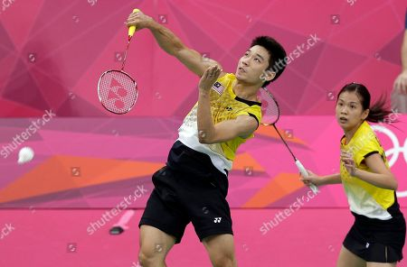Malaysia's Chan Peng Soon, left, and Goh Liu Ying play against Taiwan's Chen Hung-ling and Cheng Weng-hsing in a mixed doubles badminton match at the 2012 Summer Olympics, in London