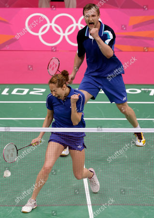Russia's Valeria Sorokina, left, and teammate Alexandr Nikolaenko celebrate after beating Britain's Chris Adcock and Imogen Bankier in a mixed doubles badminton match at the 2012 Summer Olympics, in London