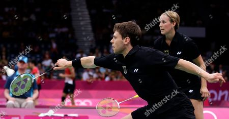 Germany's Michael Fuchs, left, and Birgit Michels play against Chris Adcock and Imogen Bankier of Great Britain during a mixed doubles badminton match at the 2012 Summer Olympics, in London