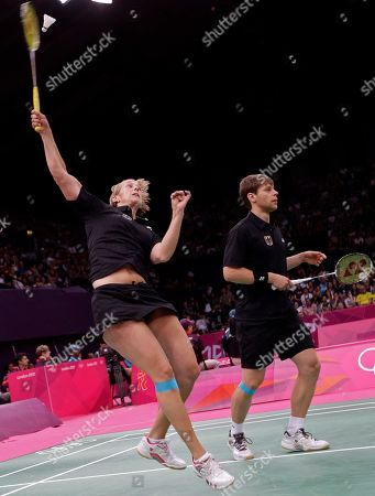 Germany's Birgit Michels, left, and Michael Fuchs play against Chris Adcock and Imogen Bankier of Great Britain during a mixed doubles badminton match at the 2012 Summer Olympics, in London
