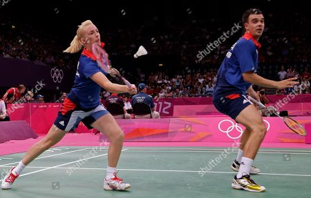 Britain's Imogen Bankier, left, returns the shuttlecock while playing with teammate Chris Adcock against Birgit Michels and Michael Fuchs of Germany during a mixed doubles badminton match at the 2012 Summer Olympics, in London