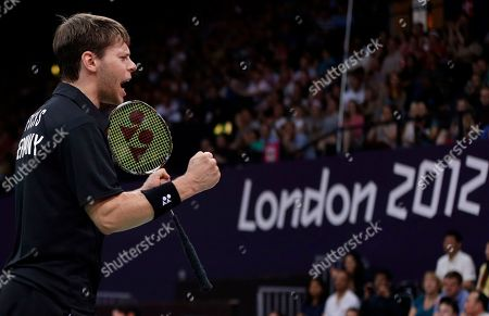 Germany's Michael Fuchs celebrates a point while playing with teammate Birgit Michels against Chris Adcock and Imogen Bankier of Great Britain during a mixed doubles badminton match at the 2012 Summer Olympics, in London