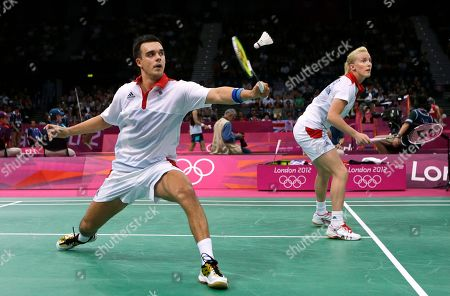 Britain's Chris Adcock, left, and Imogen Bankier play against Russia's Valeria Sorokina and Alexandr Nikolaenko, unseen, at a mixed doubles badminton match of the 2012 Summer Olympics, in London