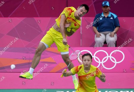 China's Xu Chen, left, and Ma Jin, play against Malaysia's Chan Peng Soon and Goh Liu Ying, unseen, at a mixed doubles badminton match of the 2012 Summer Olympics, in London