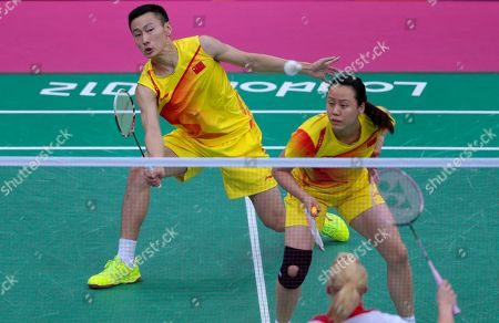 China's Zhang Nan, left, and Zhao Yunlei, play against Britain's Chris Adcock, unseen, and Imogen Bankier, foreground, at a mixed doubles badminton match of the 2012 Summer Olympics, in London
