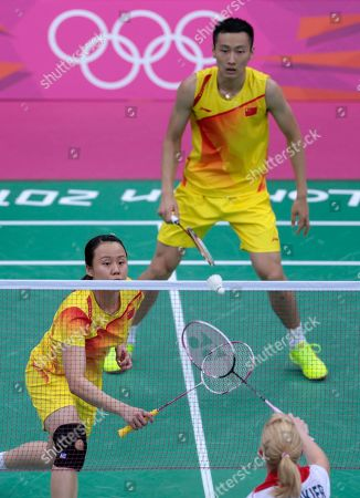 China's Zhang Nan, right, and Zhao Yunlei, left, play against Britain's Chris Adcock, unseen, and Imogen Bankier, at a mixed doubles badminton match of the 2012 Summer Olympics, in London