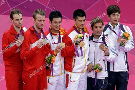 Gold medalists, China's Cai Yun, third from left, Fu Haifeng, third from right, silver medalists, Denmark's Mathias Boe, far left, Carsten Mogensen, bronze medalists, South Korea's Chung Jae-sung and Lee Yong-dae, far right, pose in the podium of the men's doubles badminton at the 2012 Summer Olympics, in London