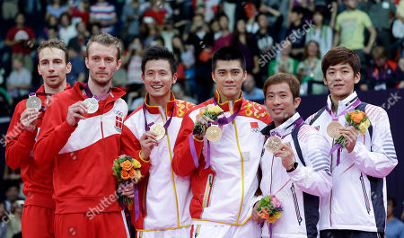 Gold medalists, China's Cai Yun, third from left, Fu Haifeng, fourth from left, silver medalists, Denmark's Mathias Boe, far left, Carsten Mogensen, second, bronze medalists, South Korea's Chung Jae-sung, fifth left, and Lee Yong-dae, pose in the podium of the men's doubles badminton at the 2012 Summer Olympics, in London