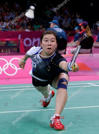 South Korea's Bae Yeon-ju plays against China's Wang Yihan, unseen, at a women's singles badminton match of the 2012 Summer Olympics, in London