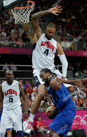 France's Ronny Turiaf is defended by USA's Tyson Chandler during the second half of a preliminary men's basketball game at the 2012 Summer Olympics, in London