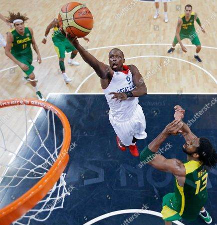 Luol Deng, Anderson Varejao, Nene Hilario Britain's Luol Deng, center, drives to the basket between Brazil's Nene Hilario, right, and Brazil's Anderson Varejao, left, during a basketball game at the 2012 Summer Olympics, in London