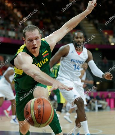 Darius Songaila, Ronny Turiaf Lithuania's Darius Songaila chases after a loose ball against France's Ronny Turiaf during a men's basketball game at the 2012 Summer Olympics, in London