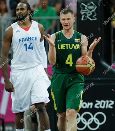 Rimantas Kaukenas, Ronny Turiaf Lithuania's Rimantas Kaukenas reacts after a foul as France's Ronny Turiaf, left, walks up court during a men's basketball game at the 2012 Summer Olympics, in London