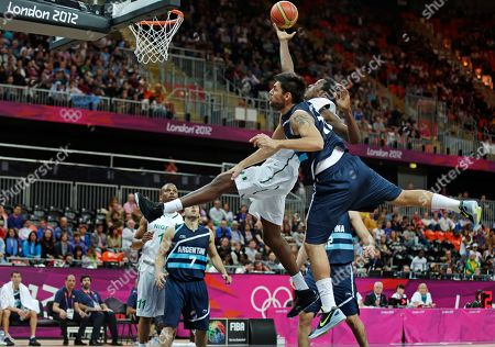 Al-Farouq Aminu, Carlos Delfino Argentina's Carlos Delfino, right, stops Nigeria's Al-Farouq Aminu on a drive to the basket during a men's basketball game at the 2012 Summer Olympics, in London