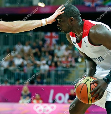 Luol Deng, Joe Ingles Britain's Luol Deng prepares to drive as Australia's Joe Ingles places his hand on his forehead during a men's basketball game at the 2012 Summer Olympics, in London