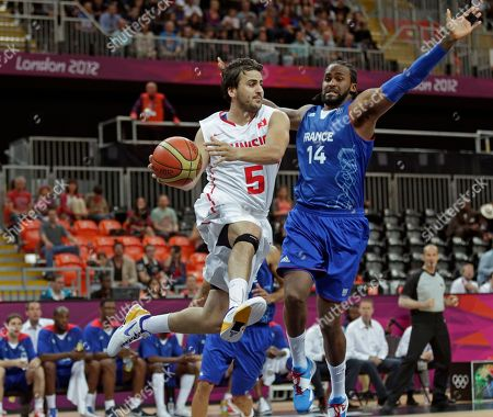 Marouan Laghnej, Ronny Turiaf Tunisia's Marouan Laghnej, left, looks to pass as he drives past France's Ronny Turiaf during a men's basketball game at the 2012 Summer Olympics, in London