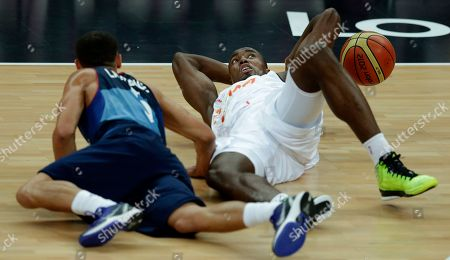 Andrew Lawrence, Serge Ibaka Britain's Andrew Lawrence, left, and Spain's Serge Ibaka battle for the ball during a men's basketball game at the 2012 Summer Olympics, in London