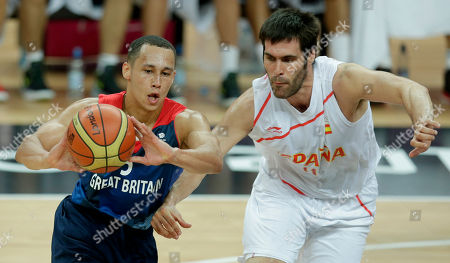 Andrew Lawrence, Fernando San Emeterio Britain's Andrew Lawrence, left, passes the ball away under pressure from Spain's Fernando San Emeterio during a men's basketball game at the 2012 Summer Olympics, in London