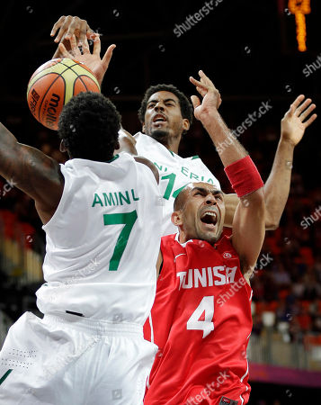 Radhouane Slimane, Al-Farouq Aminu, Alade Aminu Tunisia's Radhouane Slimane (4) is defended by Nigeria's Al-Farouq Aminu (7) and Alade Aminu (14) during the first half of a preliminary men's basketball game at the 2012 Summer Olympics, in London