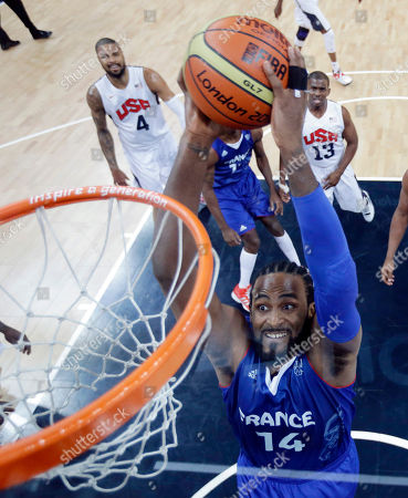 France's Ronny Turiaf goes up for a dunk during the first half of a preliminary men's basketball game against the United States at the 2012 Summer Olympics, in London