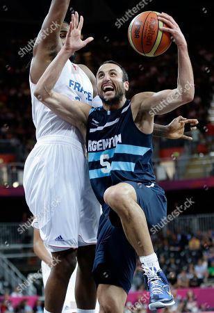 Ronny Turiaf, Manu Ginobili Argentina's Manu Ginobili (5) drives to the basket against France's Ronny Turiaf, left, during the first half of a preliminary men's basketball game at the 2012 Summer Olympics, in London