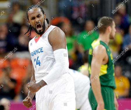 Ronny Turiaf France's Ronny Turiaf reacts to a team score during a preliminary men's basketball game against Lithuania at the 2012 Summer Olympics, in London