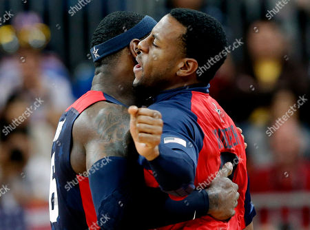 Lebron James, Andre Iguodala USA's Lebron James, left, and USA's Andre Iguodala, right, celebrate during a preliminary men's basketball game against Lithuania at the 2012 Summer Olympics, in London